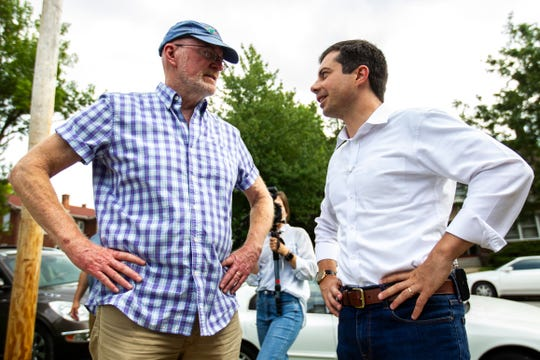 Jim Throgmorton, mayor of Iowa City, talks with Pete Buttigieg, mayor of South Bend, Indiana, before an event, Monday, Sept. 2, 2019, at College Green Park in Iowa City, Iowa.