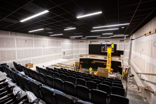 Construction continues inside a theater, Tuesday, Aug. 27, 2019, at a new FilmScene in the Chauncey building in Iowa City, Iowa.