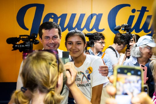 Pete Buttigieg, mayor of South Bend, Indiana, poses for a photo with Iowa City High student Soshie Hemley at a campaign office opening, Monday, Sept. 2, 2019, in Iowa City, Iowa.