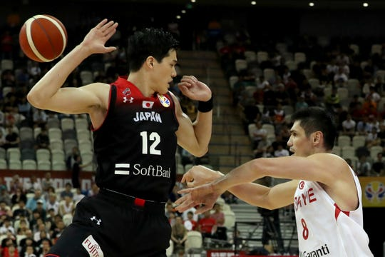 Turkey's Ersan Ilyasova throws the ball past Japan's Yuta Watanabe during a Group E match of the FIBA Basketball World Cup at the Shanghai Oriental Sports Center in Shanghai on Sunday, Sept. 1, 2019. Turkey defeats Japan 86-67. (AP Photo/Ng Han Guan)