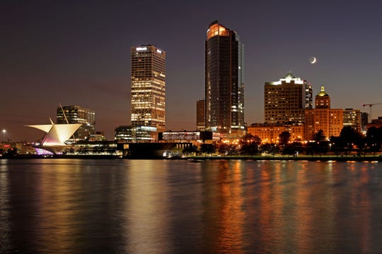 Milwaukee lights reflect off Lake Michigan on Sept. 1, 2019.