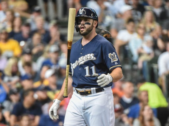Sep 2, 2019; Milwaukee, WI, USA;  Milwaukee Brewers third baseman Mike Moustakas (11) reacts after getting called on strikes in the fourth inning during the game against the Houston Astros at Miller Park. Mandatory Credit: Benny Sieu-USA TODAY Sports