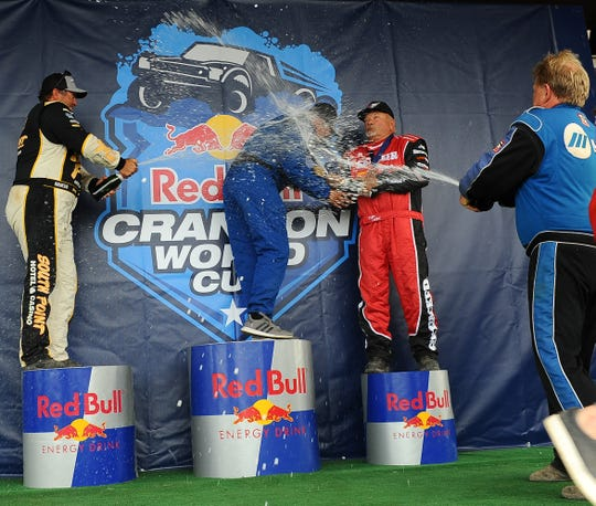 Brendan Gaughan, Carl LeDuc and Scott Taylor shower winner Randy Anderson after the Polaris RZR Crandon Race of Champions at the Crandon World Championship Off-Road Races on Sunday.