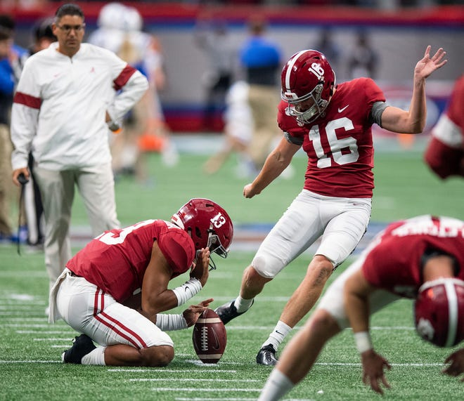 Alabama placekicker Will Reichard (16) warms up with  Tua Tagovailoa (13) holding before the Chick-fil-A Kickoff Game at Mercedes Benz Stadium in Atlanta, Ga., on Saturday August 31, 2019.