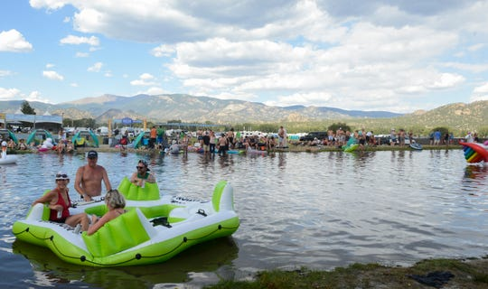 "Fans enjoy the ""Somewhere on the Beach"" section of the Seven Peaks Music Festival in Buena Vista, Colo. on Saturday, August 31, 2019. The man-made lake area is rimmed with sand and filled with filtered water that replenishes every 24 hours."