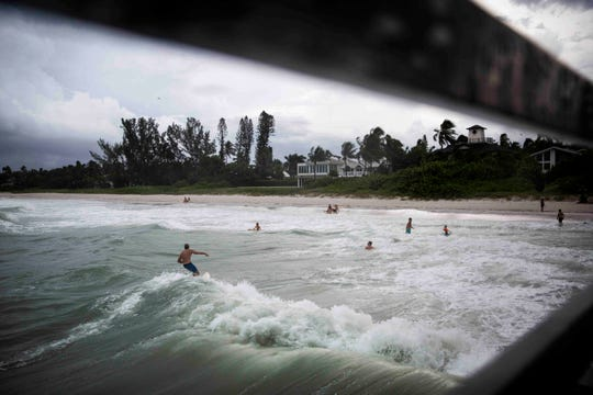 Dozens of surfers take advantage of large waves near the Naples Pier on Monday, September 2, 2019. A strong line of thunder storms moved through Naples on Monday afternoon, with wind gusts of up to 45mph, according to the National Weather Service in Miami.