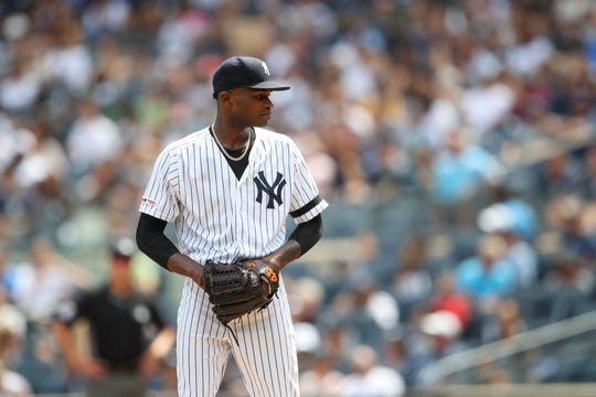 New York Yankees starting pitcher Domingo German prepares to deliver against the Oakland Athletics during the first inning of their baseball game, Saturday, Aug. 31, 2019, in New York. (AP Photo/Mary Altaffer)