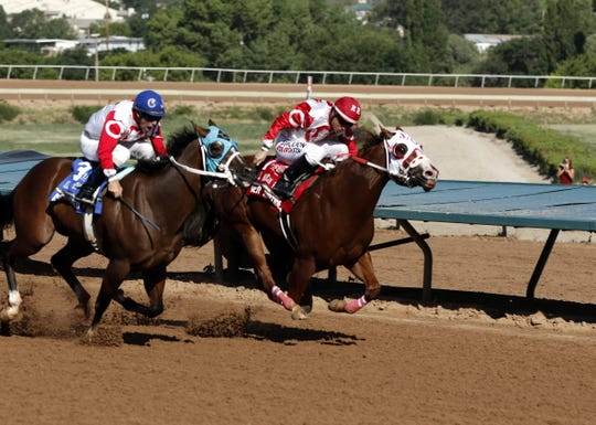 Left to right: Determined One and Mister Riptide battle midway through the 2019 All-American Futurity at the Ruidoso Downs. Mister Riptide placed and Determined One showed in the race.