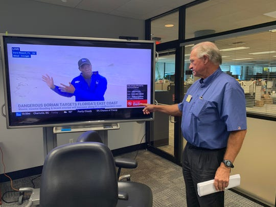 Waffle House Board Chairman Joe Rogers Jr. watches The Weather Channel for Hurricane Dorian updates on Monday, Sept. 2 at the Waffle House headquarters in Atlanta, Georgia.