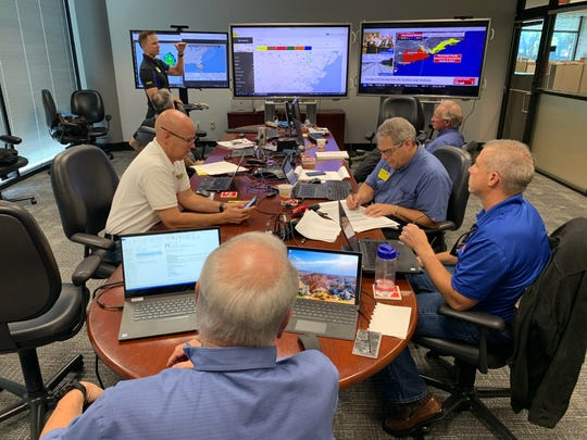 Waffle House executives gather in a conference room at their headquarters in Atlanta, Georgia on Monday, Sept. 2. The team is preparing for Hurricane Dorian, which is expected to begin affecting the United States early Tuesday.