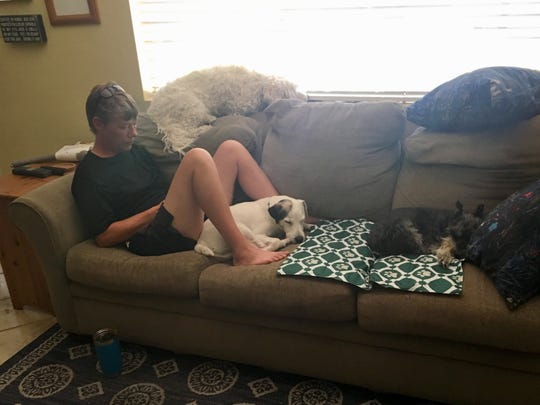 Cousin Theresa Gotter in a rare still moment, surrounded by Widdle, Oliver and Allie.
