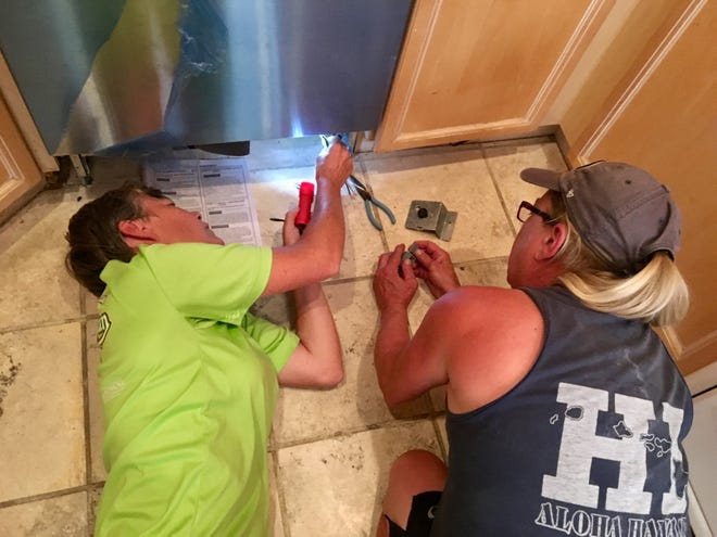 When my cousins Theresa and Janet stay at our house, things get done, including the installation of a new dishwasher.