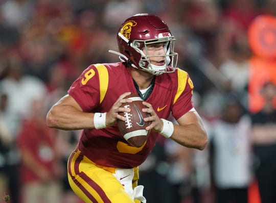 USC quarterback Kedon Slovis (9) throws the ball in the second half against the Fresno State Bulldogs at Los Angeles Memorial Coliseum. USC defeated Fresno State 31-23.