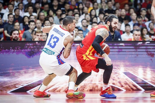 Ricky Rubio looks to get past Angel Rodriguez in Tuesday's FIBA World Cup.