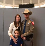Texas Department of Public Safety Trooper Chuck Pryor (right) with his wife Bridget and their 8-year-old son.