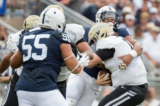 Penn State defensive end Shaka Toney (18) tackles Idaho quarterback Colton Richardson (19) in the second quarter of an NCAA college football game against Idaho in State College, Pa., on Saturday, Aug. 31, 2019. (AP Photo/Barry Reeger)