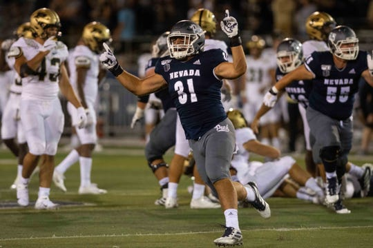 Wolf Pack tight end Reagan Roberson (31) celebrates a win over the Purdue Boilermakers at Mackay Stadium.