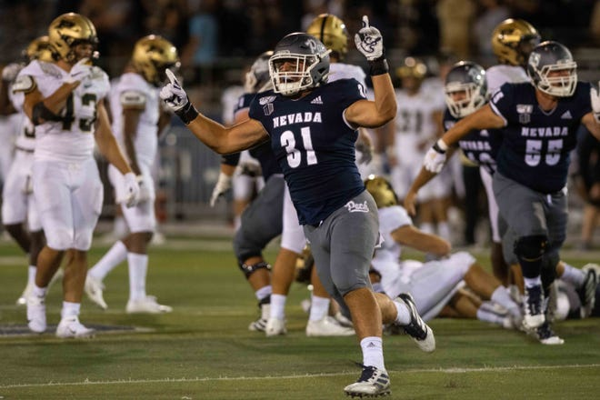 Wolf Pack tight end Reagan Roberson celebrates the Friday night win over Purdue at Mackay Stadium.