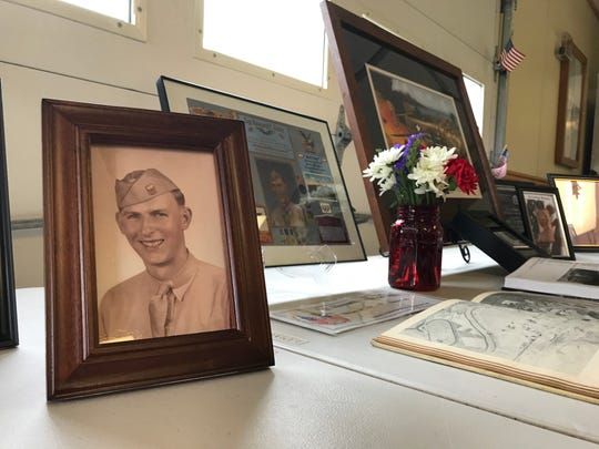 Family photos and mementos of Sgt. Howard Gotts.
