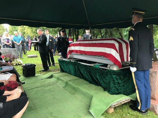 Rev. Dale Andrews speaks at the funeral of Sgt. Howard Gotts.