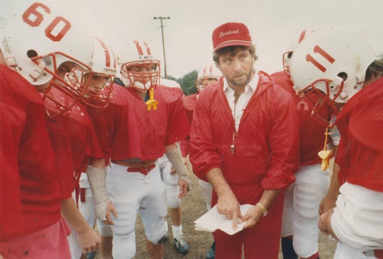 Christoval head coach Billy Barnett discusses a play during a practice with his football team in this photo from Dec. 10, 1991.