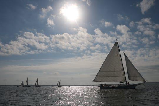 Skipjacks sail in Chesapeake Bay during the 60th annual Skipjack Race at Deal Island, Sept. 2, 2019.