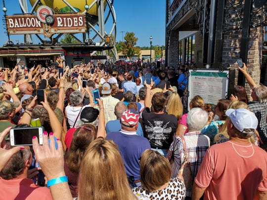 Hundreds of people crowd around trying to get a glimpse of celebrity chef Paula Deen during the ribbon-cutting for Paula Deen's Family Kitchen on Monday, Sept. 2, 2019, at Branson Landing in Branson, Mo.
