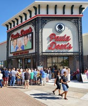 People crowd around before the grand opening of Paula Deen's Family Kitchen on Branson Landing on Monday, Sept. 2, 2019, in Branson, Mo.