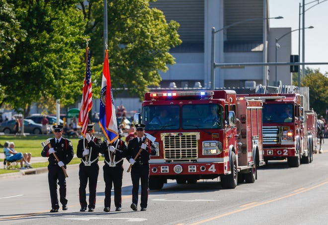 The Springfield Fire Department Honor Guard leads off the Labor Day Parade on Monday, Sep. 2, 2019, in Springfield, Mo.