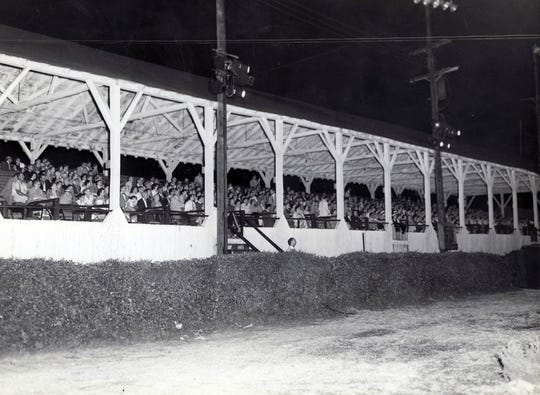 """The grandstands in Gypsy Hill Park are packed with people who have come out to see """"The Eleventh Hour,"""" in this old photo."""