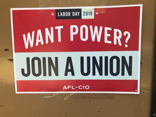 A sign is posted at a Labor Day picnic with local unions in Riverside Park Monday afternoon, Sept. 2.