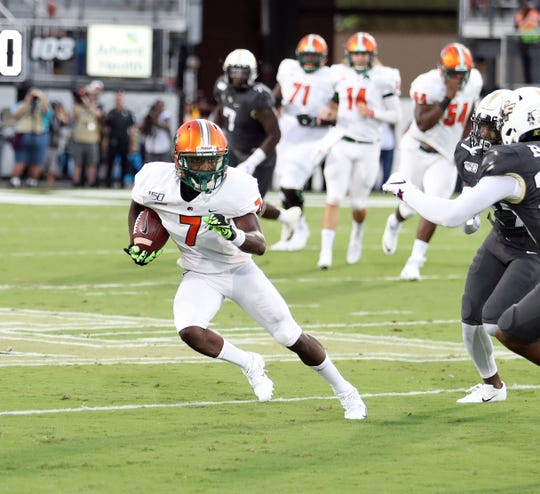 FAMU wide receiver George Webb dashes by the UCF defense. The Rattlers lost to the Knights in the season opener on Thursday, Aug. 29, 2019 at Spectrum Stadium in Orlando.