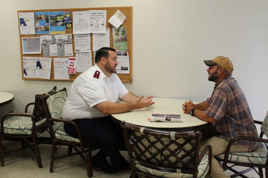 Lt. Jeff Marquis of the Salvation Army meets with Gregg, a resident at Adam's Place. Gregg recently entered the shelter to gain stability. He's excited to start college.