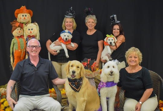 The Dogs For Life Howl-O-Ween Pawrade Planning Committee, from left, back row, Kim Prado with service puppy Jasper, Dogs for Life Founder and CEO Shelly Ferger and Vanessa Bartoszewicz with service puppy Savanna; front row, Service Dog Teams Michael Stewart with Good Girl and Barbara Gormas with Lola.