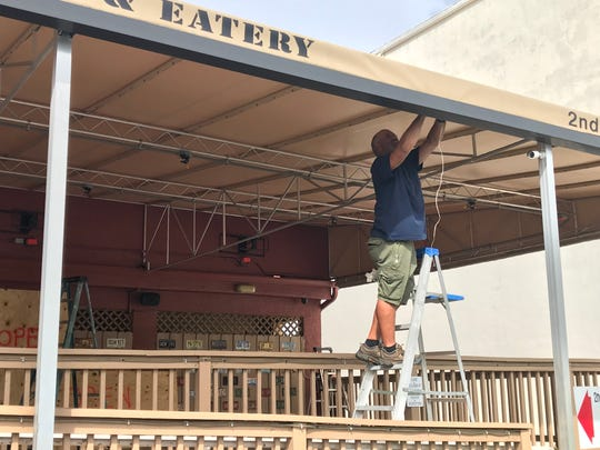 Randy Snare prepares 2nd Street Bistro for Hurricane Dorian on Monday morning.