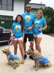 Sam Ruo and Tessa, left, Steven Luriea and Cassidy Johnston with Bingo at the Humane Society of Treasure Coast's 2019 Pup Crawl in downtown Stuart.