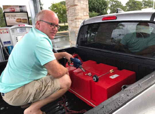 "Peter Deaton of Stuart fills a boat tank with gasoline about 8 a.m. Monday, Sept. 2, 2019, at Wawa at Kanner Highway and Monterey Road in Stuart, Florida. ""I'm surprised they have rec fuel,"" he said, adding the non-ethanol fuel is better for generators."