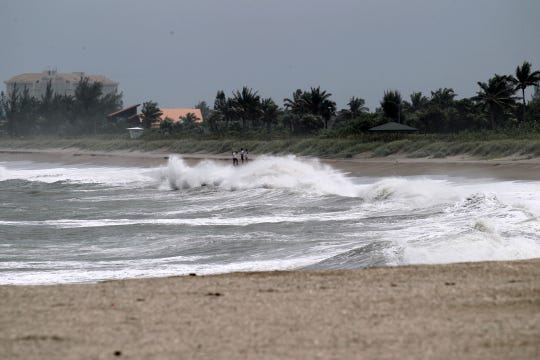 Rough surf hits the shoreline of Fort Pierce Beach on Monday, Sept. 2, 2019, as heavy swells from Hurricane Dorian stir the water along the Treasure Coast beaches.