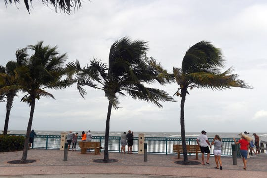 Local residents gathered at Sexton Plaza in Vero Beach on Monday, Sept. 2, 2019, to feel the wind and watch the high surf as Hurricane Dorian slowly makes its way toward the Florida east coast. The storm is expected to bring high winds, flooding and beach erosion to the Treasure Coast.