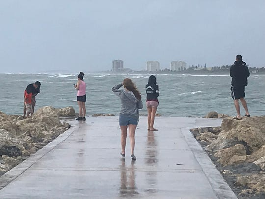 "People watch the waves coming in on Monday, Sept. 2, 2019, at Jetty Park in Fort Pierce. ""I've been around the water my whole life,"" said Eric Lamplough of Fort Pierce. ""It's impressive what Mother Nature can do. But this is nothing yet."""