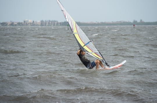 Windsurfers move fast along the shoreline of the Indian River Lagoon in Jensen Beach on Monday, Sept. 2, 2019, as people in the area prepare for the effects from Hurricane Dorian.