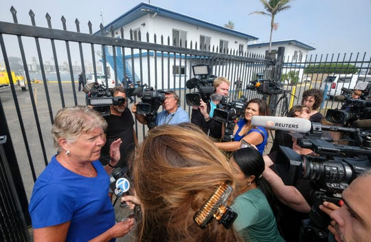 Rep. Julia Brownley talks to media outside U.S. Coast Guard Station Channel Islands in the hours after the Conception dive boat fire in September.