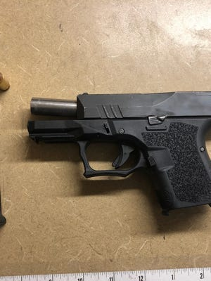 Three people were found with a gun by Visalia police on Sunday, Sept. 1, 2019.