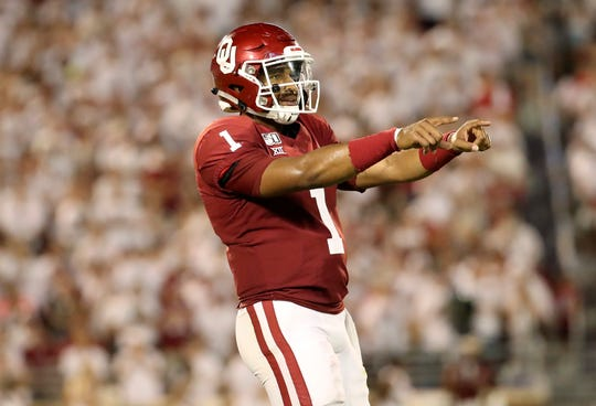 Oklahoma quarterback Jalen Hurts reacts after throwing a touchdown pass during the third quarter against Houston.