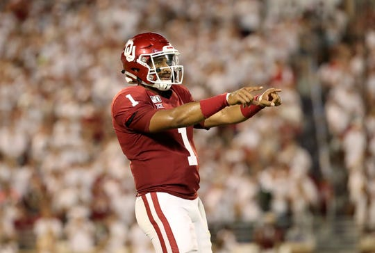 Oklahoma Sooners quarterback Jalen Hurts reacts after throwing a touchdown pass during the third quarter against the Houston Cougars at Gaylord Family-Oklahoma Memorial Stadium.