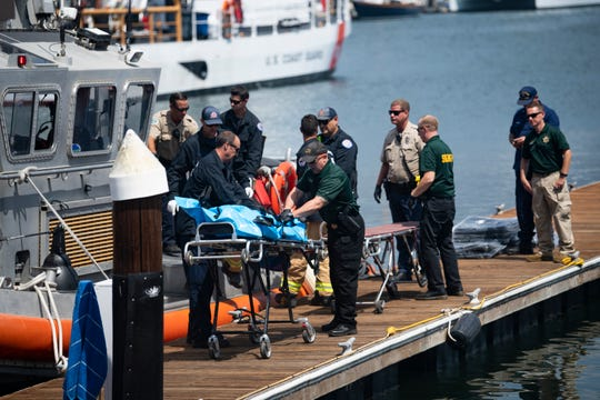 United States Coast Guard members transfer a body at the Santa Barbara Harbor on Sept. 2, 2019.
