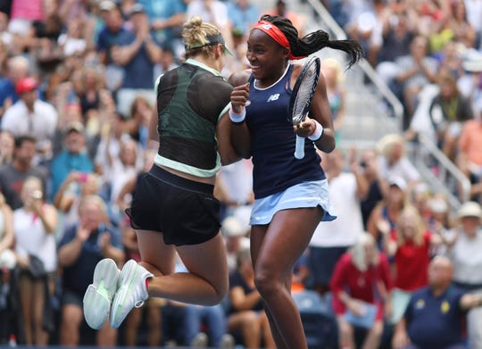 Coco Gauff, right, and her partner Caty McNally celebrate after winning their women's doubles match.