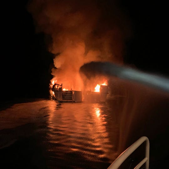 In this photo provided by the Ventura County Fire Department, firefighters respond to a boat fire off the coast of Southern California on  Monday.