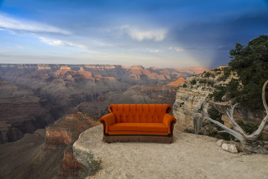"""Warner Bros. made 30 replicas of the iconic """"Friends"""" Central Perk couch and is placing them at locations around the world, including the Grand Canyon, to celebrate the 25th anniversary of the hit comedy's premiere, on Sept. 22, 1994."""