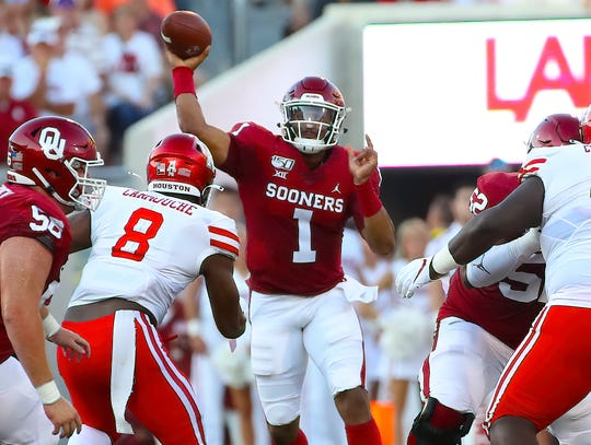 Oklahoma quarterback Jalen Hurts  throws during the first half against  Houston at Gaylord Family - Oklahoma Memorial Stadium.